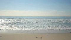 Waves wash ashore Stock Footage