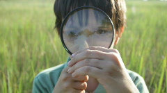 The boy with a magnifier Stock Footage