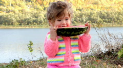 Baby eating ripe watermelon Stock Footage