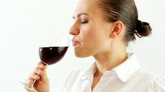 Elegant woman tasting wine Stock Footage