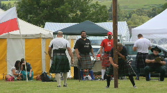 Man struggles with caber Stock Footage
