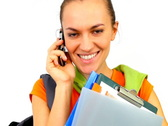 Young female student talking on cellphone, isolated Stock Footage