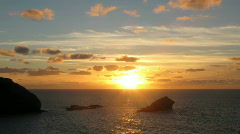 Sunset timelpase Gull rock Portreath Cornwall UK. - stock footage