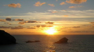 Stock Video Footage of Sunset timelpase Gull rock Portreath Cornwall UK.