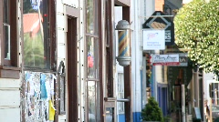 Old barber shop and storefronts Stock Footage