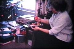 Opening Christmas Stockings (1964 Vintage 8mm film) - stock footage