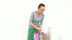 Woman with shopping bags trying on t-shirt, isolated Stock Footage