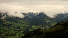 In The Alps 19 Mountains and Clouds Pans Stock Footage