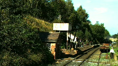 Steam train moving though a train station Stock Footage