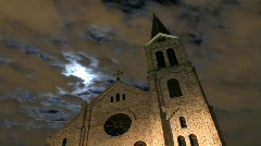 Full Moon and Clouds behind Old Church Timelapse Stock Footage
