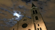 Stock Video Footage of Full Moon and Clouds behind Old Church Timelapse