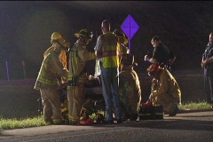 Fire Rescue Team Help Man on Side of Road Stock Footage