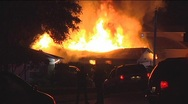 Cops stand in front of house fire Stock Footage