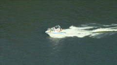 ZOOM OUT SPEEDBOAT ON RIVER_PORTLAND Stock Footage