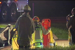 Fire Rescue Team Help Injured Driver in Ditch Stock Footage