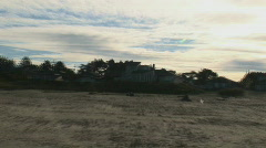 ZOOM OUT HOUSE ON BEACH ORE Stock Footage