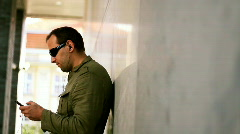 Man with mp3 player listening to music, dolly shot  Stock Footage