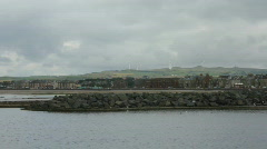 Coastal town with wind turbines Stock Footage