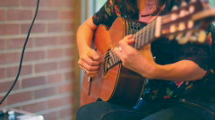 Close up of woman's hands strumming 6 string guitar DOF 6 Stock Footage