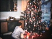 Stock Video Footage of Opening Christmas Presents (1963 Vintage 8mm film)