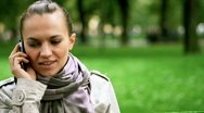 Young woman talking on mobile phone, dolly shot Stock Footage