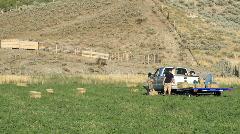 Men loading hay on truck trailer farm P HD 7860 Stock Footage
