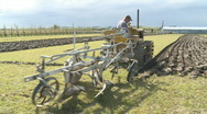 Stock Video Footage of Vintage tracked tractor ploughing field