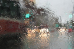 Intersection through rainy windshield. SD. Stock Footage