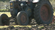 Stock Video Footage of Vintage Lanz tractor and old plough