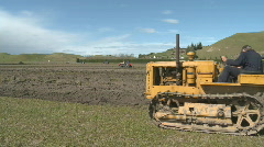 Vintage crawler tractor and plough Stock Footage