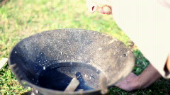 Preparing grill, slow motion shot at 60fps Stock Footage