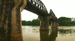 The Khwae Yai River Bridge on the River Khwae WW2 Historic POW Death Railway  Stock Footage