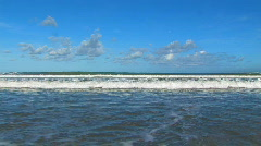 Sea and waves on the ocean shoreline tropical beach clouds blue horizon peace Stock Footage
