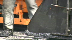 Workers Apply Asphalt to Road Crew Repair Making New Road Surface  Stock Footage