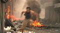 Man Runs Burning Streets Civil War Terrorist Attack Smoking Ruins Bombed City HD Footage