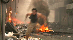 Man Runs Burning Streets Civil War Terrorist Attack Smoking Ruins Bombed City Stock Footage