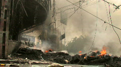 BURNING STREET CIVIL WAR Terrorist Attack Smoking Ruins Bombed City End of World Stock Footage