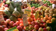 Stock Video Footage of Fruit in bins at farmers market, Seattle. Pan left.