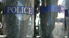Police Line riot shields and clubs  Bangkok Swat Squat Protest Demonstration Stock Footage