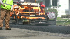Workers Apply Asphalt to Road Stock Footage