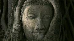 Buddha head overgrown by tree, Thailand Stock Footage