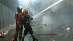 Firefighters Battle FIRE! Safety Emergency Blazing Building HEAT HOSE Water Stock Footage