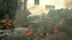 BURNING CITY STREET Bomb Blast Ruined Store TERROR Attack Bomb Riot Bangkok 2010 - stock footage