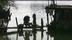 Vietnamese Woman Washes Laundry by the Riverside Scenic Vietnam Shack Poverty  Stock Footage