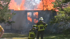 House Fire + firefighters on the scene  Stock Footage