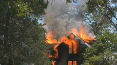 2 story home, burning, engulfed in flames Stock Footage