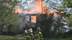 House Fire + Firemen on the scene  Stock Footage