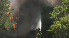 House Fire - engulfed + 2 firemen Stock Footage