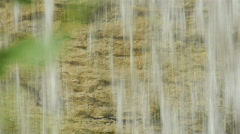 Waterfall on eroded limestone rock during autumn Stock Footage