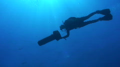 Silhouette of diver with DPV/Diver propulsion vehicle. - stock footage